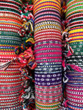 Woven bracelets. Colorful woven bracelets in pink, yellow, red and green, friendship bracelets Stock Images