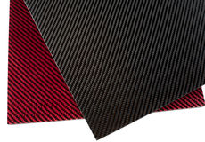 Woven carbon fiber and carbon-kevlar composite sheet. Stock Photo