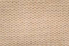 Woven carpet texture. Light yellowish-brown woven wool carpet texture royalty free stock photography