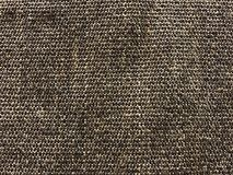 Woven carpet texture from sisal for background. Dark woven sisal carpet texture and background Royalty Free Stock Photo