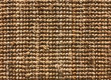 Woven carpet texture from sisal or natural fiber for background. Brown woven sisal or nature fiber carpet texture and background royalty free stock photography