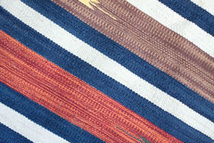 Woven cloth with color stripes as background Stock Photo