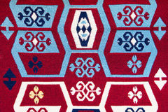 Woven cotton rug with many colors. Rustic woven carpet early last century used as dowry royalty free stock photos