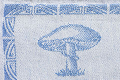 Woven design of a mushroom. Macro shot of a woven design of a mushroom on a kitchen towel Royalty Free Stock Image