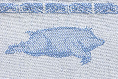 Woven design of a pig. Macro shot of a woven design of a pig on a kitchen towel Stock Photo