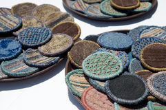 Woven drink coasters in sunlight on bar table Royalty Free Stock Photo