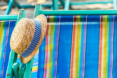 Woven hat on the beach chair Royalty Free Stock Photography