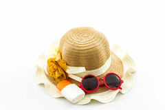 Woven hat with body lotion and red sunglasses. Royalty Free Stock Image