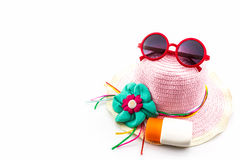 Woven hat with body lotion and red sunglasses. Stock Images