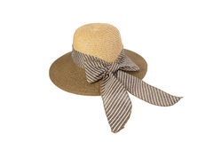 Woven hat with brown, decorated with a pink bow tie. Royalty Free Stock Image