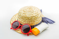 Woven hat, red sunglasses with body lotion. Royalty Free Stock Photo