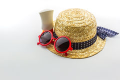 Woven hat, red sunglasses with body lotion. Stock Photography