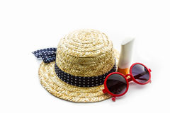 Woven hat, red sunglasses with body lotion. Stock Photo