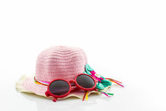Woven hat, with red sunglasses . Royalty Free Stock Images