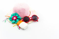 Woven hat, with red sunglasses. Royalty Free Stock Image