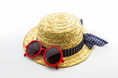 Woven hat with red sunglasses. Royalty Free Stock Images