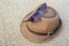 Woven hat with sunglasses. Stock Photos