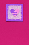 Woven heart on a pink background Royalty Free Stock Photos