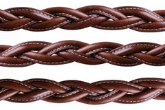 Woven leather. Woven brown leather belt isolated on white Stock Images