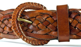 Leather Belt Buckle. Belt buckle and  woven leather belt Stock Photo
