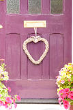 Woven love heart hanging from letterbox Stock Photography
