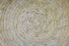 A woven Mat of reeds or straw-yellow in color. The texture of dry cane. Dark yellow. Woven circle Mat of reeds or straw-yellow in color. The texture of dry cane stock image
