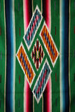 Woven mexican sarape. Colorful central medallion of a woven mexican sarape Stock Photo