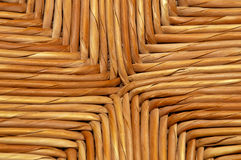 Woven natural wicker background detail. A woven wicker surface made up of strands of reeds woven together close up Stock Photos
