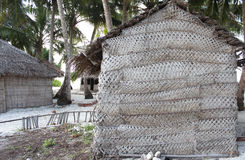 Woven palm leaves home. In olden days, how Maldives people makes home by using palm leaves Stock Image