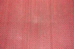 Patterns knit on the red mat. stock image