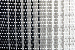 Woven rattan with black grey white shade Stock Images