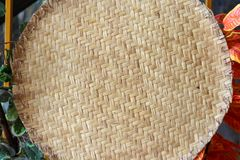 Woven rattan in a circle with a flower background royalty free stock image