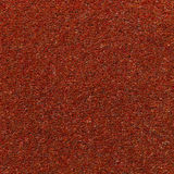 Woven red carpet texture. Woven red carpet fabric texture stock photo