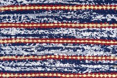 Woven rug fabric on the background. Close up. Woven rug fabric on the background. Cloth, typically produced by weaving or knitting textile fibers. Close up stock image