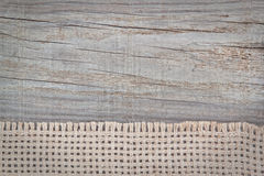 Woven sackcloth on the texture of the wood. Stock Photo