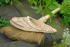 Woven sneakers and broom Royalty Free Stock Photography