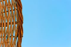 Woven straw of a beach umbrella on a blue sky Royalty Free Stock Photo