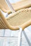 Woven straw chair. Bright view of an woven straw chair - Vertical, selective focus Royalty Free Stock Photography