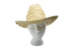 Woven Straw Hat. Woven straw farmers hat on a styrofoam head, isolated on white background royalty free stock images