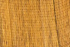 Woven straw texture. Handmade woven rug. flaxen weaving yellow mesh close up image royalty free stock photography