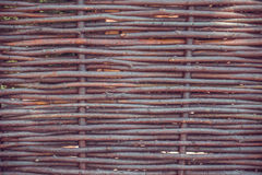 Woven willow fence. Rustic style stock photo