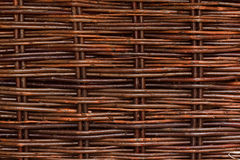 Woven willow wicker background. A woven willow wicker fence panel suitable for crafts, picnic or gardening background or wallpaper Stock Photo