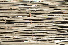 Woven willow wicker fence Royalty Free Stock Image
