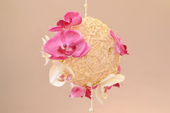 Woven wood sphere decorated with orchids Stock Photo
