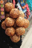 Woven wooden balls. Close up of several woven woodens balls for sale Stock Photography