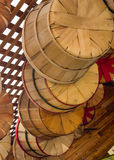 Woven wooden baskets hanging up in barn Stock Photography