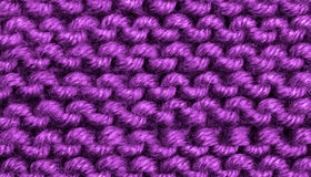 Woven Wool Background. Background of Purple Natural Weave Wool closeup Stock Image