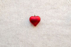 Woven wool white fabric texture . Place for text. Woven wool white fabric texture with with red decorative heart Stock Photos
