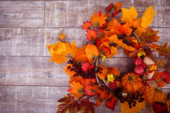 Woven wreath decorated orange leaves, autumn vegetables Royalty Free Stock Photos