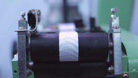 Woven yarn is wound onto the spool. stock video footage